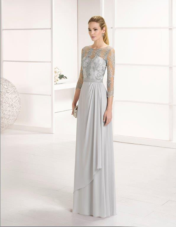Full length chiffon dress with fitted bodice and long sleeve.