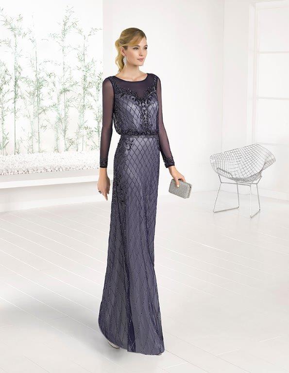 Full length beaded dress with mesh sleeves.