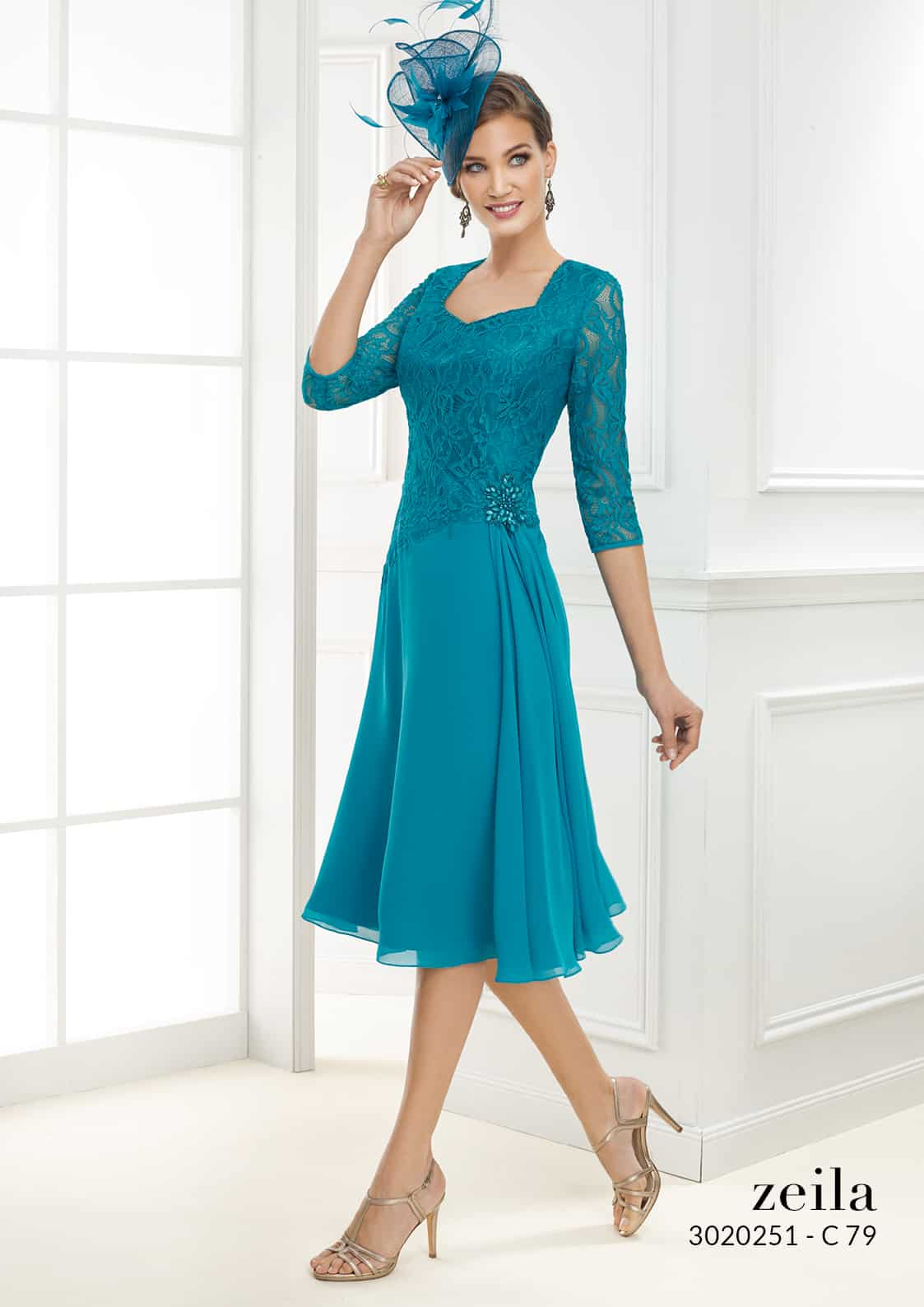 A-line style dress with lace bodice and lace sleeves.