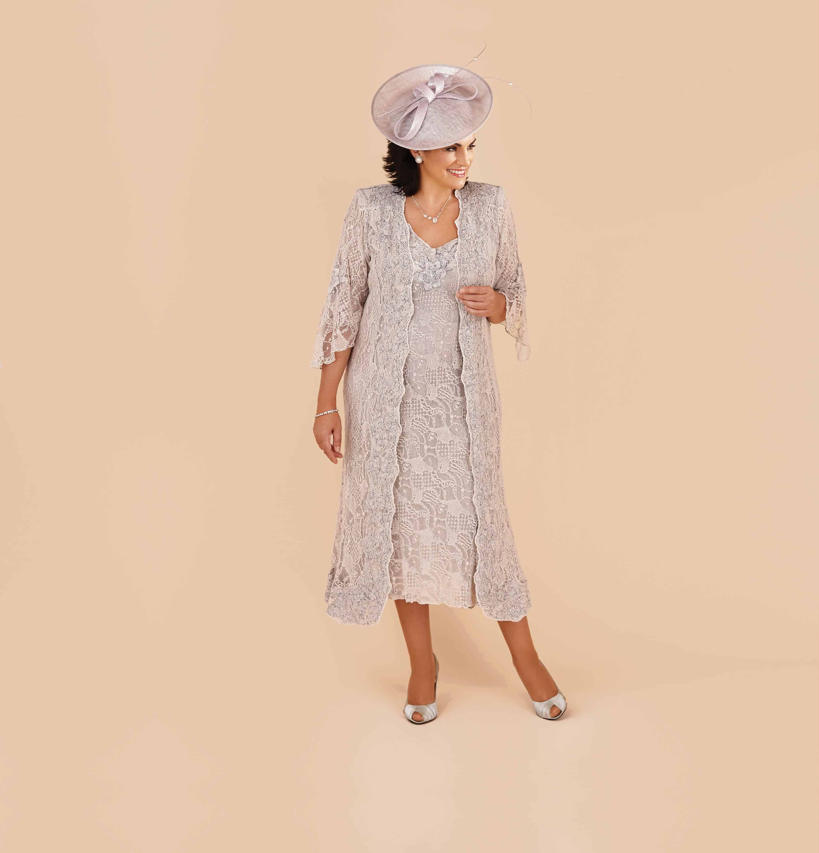 Italian fitted lace dress and long coat.