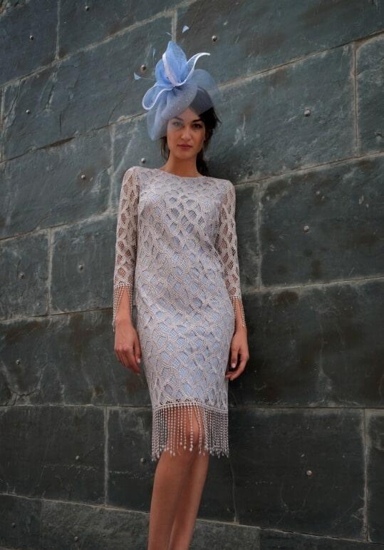 Knee length dress with tassel bottom.