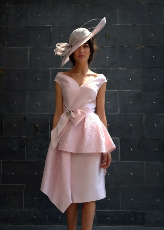 Knee length dress with peplum detail with bow.