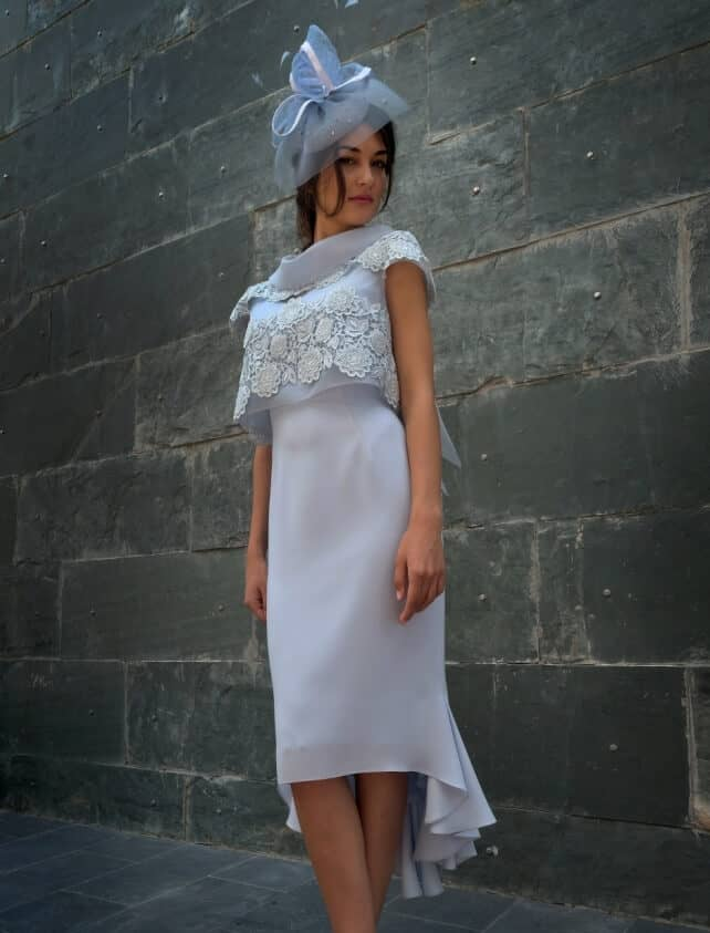 Mid length dress with backwards sheer jacket with tail bottom.