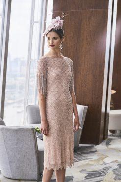 Mid length beaded dress with tassel sleeves.