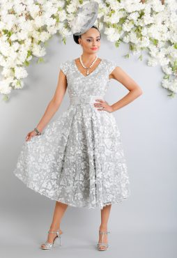 Flattering A-line fit and flair, tea length v neck lace dress with belt. Eye catching and full of the WOW factor. Available in silver - D896 (003967)