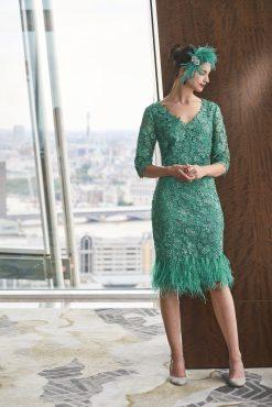 Knee length dress with feather hem.