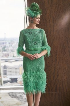 Knee length dress with feather hem and feather cuffs.