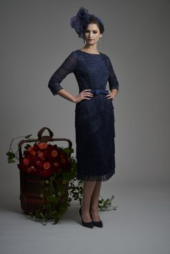 This stunning dress has been made by the finest ateliers and as such it is embellished y hand so no two pieces are alike. Fully lined this exquisite dress has one of the designers signature trademark of fringes making up the full skirt and 3/4 length sleeves. Round neckline and the bodice is covered in sequence. Royal blue- 5009 (004493)
