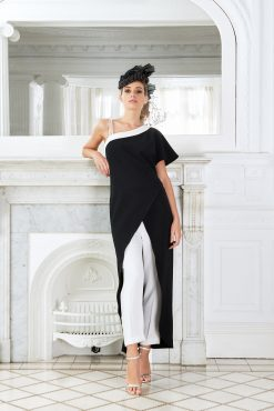Flattering trouser with eye catching long open fronted top and one sleeve. Available in black/white - T528 (004518)