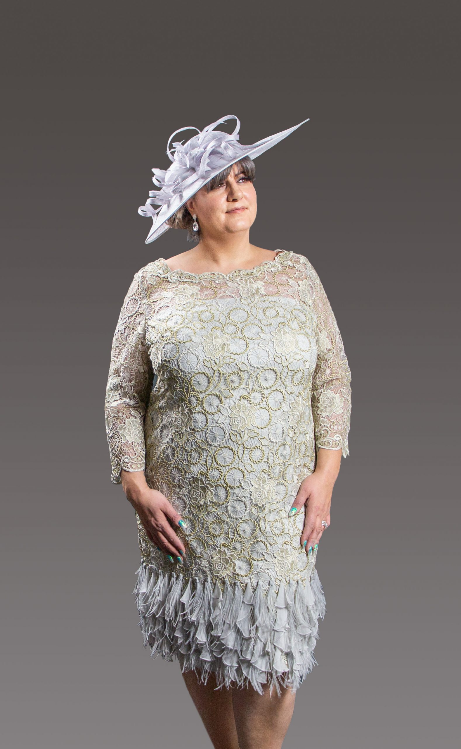 This stunning dress has been made by the finest ateliers and as such it is embellished y hand so no two pieces are alike. Fully lined this exquisite dress has one of the designers signature trademark of feathers around the bottom and 3/4 length sleeves. Available in so many choices of colour there is a shade to suit all skin tones. Gold - 3015 (003608)