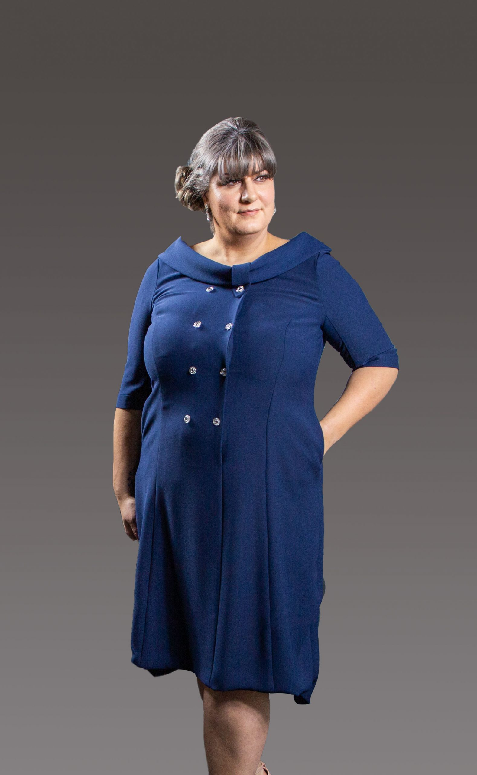 High-Low/dipped hem designed coat dress. Boat neckline and eye catching diamante buttons makes this stunning dress stand out in a crowd. Navy and Blush - 8054- 2 - 3923 - 0259 (004296)