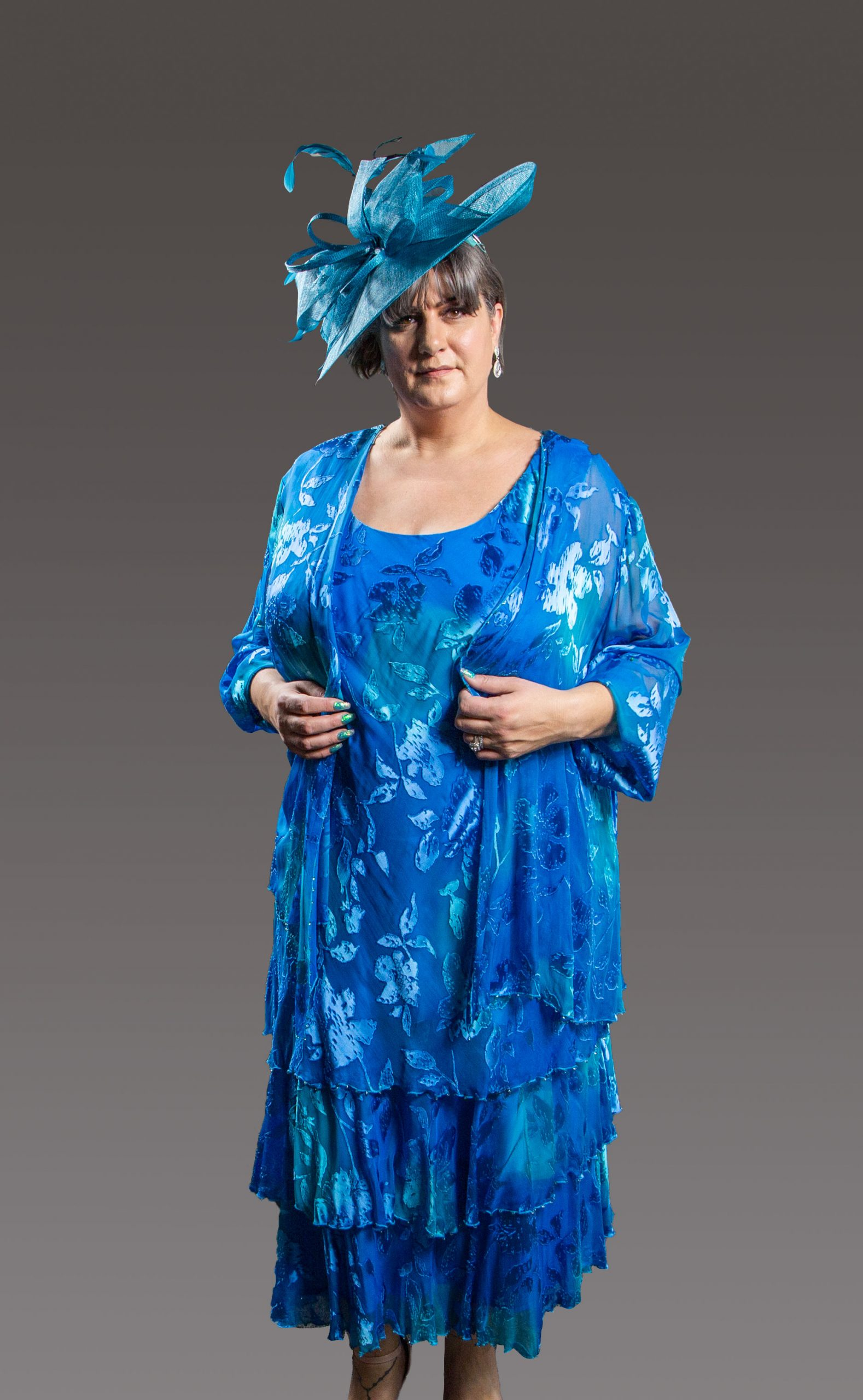 This stunning fully lined dress is beautifully presented with layers of soft and sensual silk layered over high quality lining creating a clean silhouette and teamed up with the waterfall fronted jacket it is a touch of class but with all the comfort. Turquoise - CP110506 (001326)