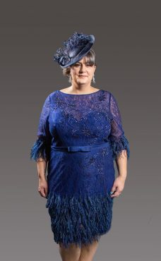 This stunning dress has been made by the finest ateliers and as such it is embellished y hand so no two pieces are alike. Fully lined this exquisite dress has one of the designers signature trademark of feathers around the bottom and 3/4 length sleeves. Sweetheart neckline is covered gently with a layer of the finest lace. Available in so many choices of colour there is a shade to suit all skin tones. Royal blue- 4018 (003962)