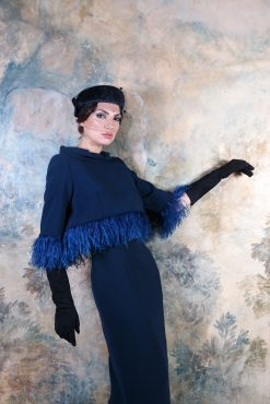 Sensual fitted, knee length sleeveless dress with show stopping feather detailed jacket. Pictured in blue however available in a variety of colours - 004213 (19502/210)